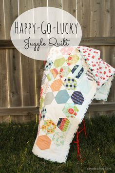 Happy Go Lucky Juggle Quilt via createcraftlove.com #quilting #hexagons #hexielove #sewing  Love the color combos!