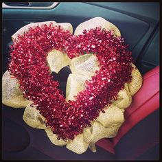 Burlap wreath with dollar store interchangeable holiday centers!! Genius! You never have to take it down