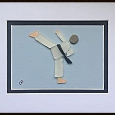 Which sports image would you like to see created with genuine sea glass and stone? Check out @TTTSEAGLASS on Facebook. Custom orders and shipping available. #karate #martialarts #sports #seaglass #seaglassart #novascotiaart