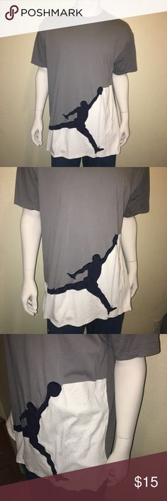 Nike Air Jordan XXL Gray and White Jumpman T-Shirt XXL Nike Air Jordon Jumpman t-shirt. Gray base with a white bottom separated by a black Jumpman. Excellent used condition. 100% cotton. Nike Shirts Tees - Short Sleeve