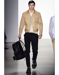 GQ.com: Calvin Klein CollectionThe killer thing about Designer Italo Zucchelli's collection is that it's modern and forward pushing without being sprockety. Khaki and black is a big theme, and it doesn't get any easier to pull off than that color combination. I've lost count of all the great hip-length jackets we've seen already, from bomber to baseball to varsity to jean jackets—and this is another strong one. Italo has taken the trucker jacket, re-colored it, and stripped it down..