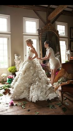Getting Ready for the ceremony with the bridesmaid..also look at how short the dress is she is wearing..