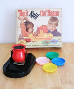 Don't Spill The Beans Game 1960s - loved this. I used to play by myself, just trying to see how many beans I could balance. I bought my daughter all those old games I loved ... the new ones are often just cheap junk, wish I'd saved my old ones!