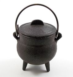 "Plain cast iron cauldron with lid and handle. This cauldron is made in a two part casting process and may have visible and/or rough seams. H= 3"" W= 2.5"" In modern witchcraft the cauldron is symbolic o"