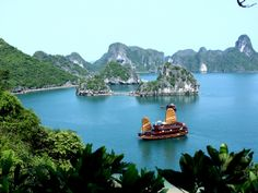 Spend a night on a junk boat in Halong Bay, Vietnam.