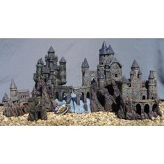 Castle fish tank decoration....you know it kinda looks like hogwarts! It would be nice to have for my soon to be hp themed fish tank, to bad it's too expensive