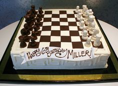 Rosebud Cakes... Cake decorated as a chess board. All edible chocolate, white chocolate and buttercream decoration