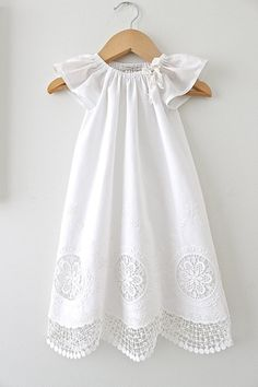 This is a beautiful vintage look long christening dress with angel sleeves and made in antique white cut out lace cotton and finished with a delicate