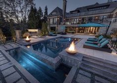 Everyone loves luxury swimming pool designs, aren't they? We love to watch luxurious swimming pool pictures because they are very pleasing to our eyes. Now, check out these luxury swimming pool designs. Pool Fence Cost, Glass Pool Fencing, Swimming Pool Pictures, Swimming Pool Designs, Ontario, Indoor Jacuzzi, Luxury Swimming Pools, Mansions Homes, Luxury Mansions