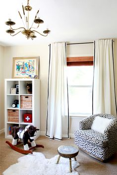 Design Crisis Erin Williamson nursery - love the spotted rocker & ribbon curtains