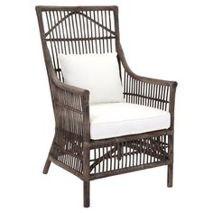 A perfect addition to island-chic rooms and country farmhouses alike, this handcrafted rattan arm chair showcases a high-back and an openwork design.