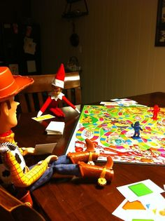 Elf on the Shelf playing cadyland with Woody!