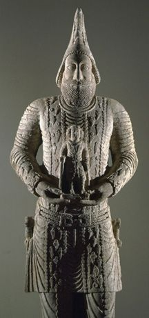 Statue of a Parthian Hatra king holding a votive figure. Hatra was an ancient city in the Ninawa Governorate and al-Jazira region of Iraq, near Mosul. It was known as al-Hadr, a name which appears once in ancient inscriptions, and it was in the ancient Persian province of Khvarvaran. It was built circa 3rd-2nd centuries BCE and flourished 1st to 2nd centuries CE under the Parthians. Many artifacts and much of the remains of the city destroyed by ISIL