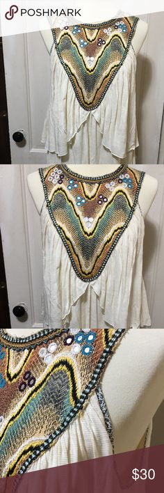 """🎉BOGO🎉🌸Free People Boho Top🌸 This top is cream with a mirrored tapestry inset and beadwork around the neckline.  It has 5 small wooden buttons at back neckline.  Size says L, but fits more like a M.  Pit to pit is 19"""" and shoulder to hem is 27"""".  🌸🌸🌸🌸🌸🌸🌸🌸🌸🌸🌸🌸🌸🌸🌸🌸🌸🌸🌸🌸🌸 Free People Tops"""