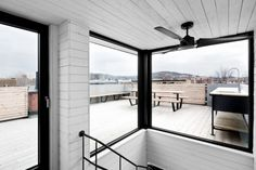 Esplanade Residence by Emilie Bédard and Maria Rosa Di Ioia » CONTEMPORIST.  Black framed windows and black fan.