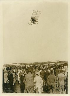 Early photoshop? A crowd watches a flying bike - actually a photo montage created as an April Fools' joke by a German newspaper. c. 1925