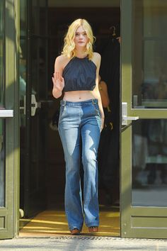 Elle Fanning is definitely channeling the '70s with her crop top and flared denim, which is a major trend come fall