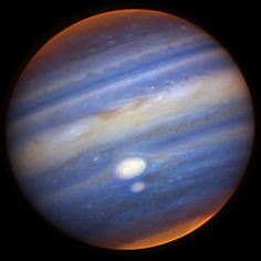 Gemini captures close encounter of jupiter's red spots. In this colour composite image, white indicates cloud features at relatively high altitudes; blue indicates lower cloud structures; and red represents still deeper cloud features. (Photo: PPARC)