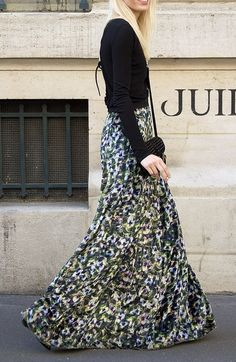 Floral patterned maxi skirt topped with simple black long-sleeved shirt  You can find similar items like this at www.occasionallblackandwhite.com
