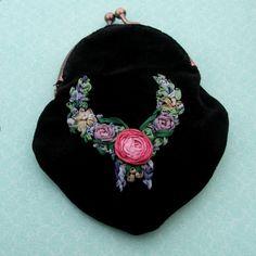 Silk ribbon embroidery on velvet.