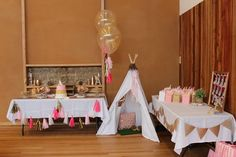Pink and gold first birthday party! Couldn't choose between teepee or bow and arrow theme so I did a combination of both :)