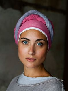 (Umbria, Italy   Steve McCurry) The colour palette of this image comes together perfectly, allowing it's focus to be on the natural beauty that the woman holds.