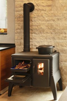 Wood Stove Decor, Wood Stove Wall, Wood Stove Hearth, Wood Burning Cook Stove, Wood Stove Cooking, Fireplace Mantle, Fireplace Design, Fireplace Inserts, Tiny Spaces