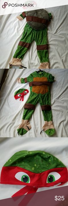 Boy's 3T-4T Ninja Turtle Raphael Halloween Costume Size 3T-4T Rubie's brand Ninja Turtle Raphael costume in good used condition. Suit velcros in back & shell velcros around waist. Rubie's Costumes