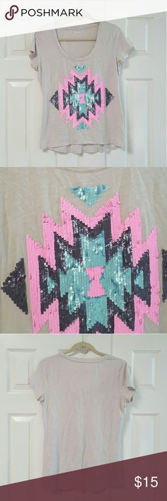 Express Sequin Short Sleeve Shirt . The shirt is 60% cotton and 40% Modal. Has a colorful sequin design on the front in aqua black and pink.   *Gently washed and worn.  *Condition: Good, used, functional could be one/few minor flaws. No noticeable rips or stains. We try to note every flaw but sometimes we miss the smallest ones please be aware of this before purchasing a used item.  Does not appear to be any sequins missing but with the thousands it could be missing one or two. Express Tops…