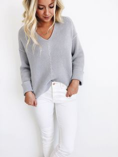 grey sweater, white jeans