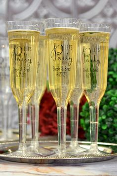 Keepsake Wedding Toasting Glasses - Help wedding guests toast the happy couple with 5 ounce clear plastic disposable champagne flutes personalized with a wedding design and two lines of custom print to include the bride and groom's name and wedding date. Wedding Toasting Glasses, Toasting Flutes, Plastic Champagne Flutes, Champagne Glasses, Champagne Flute Favors, Wedding Toasts, Personalized Cups, Wedding Keepsakes, Wedding Reception
