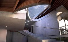 sculptural-home-plays-volumes-curvy-roofline-8-stairwell.jpg