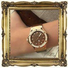 Women watches:  Women's Hublot Caapuccino watch with a diamond bezel at Oster.