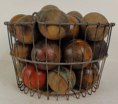 """Vintage Wooden Balls. Old vintage farmers egg basket filled with 32 antique wooden balls from various games including croquet. Basket measures 8 1/2"""" tall and 14 1/2"""" wide."""