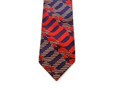 Mens vintage 70s artsy necktie in great condition and ready to wear - tiny bumps on the lining that do not affect the look of the tie - very unusual and unique pattern    4 wide - 55 long   Labeled Bonds   Imported Italian textured acetate   Design woven (not printed)