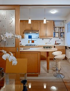 The Pocket-Galley Kitchen: This solution is especially great for city apartment dwellers. In this layout, the kitchen is designed like a galley but is hidden from the dining room with pocket doors which can also be used to conceal a wet bar area.