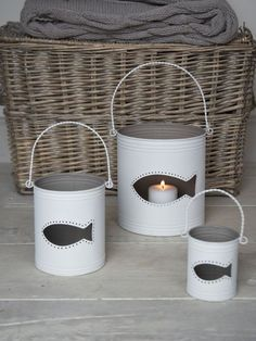 Tin lanterns to hold tealights with fish shape cut outs on the side. #coastal #lakehouse