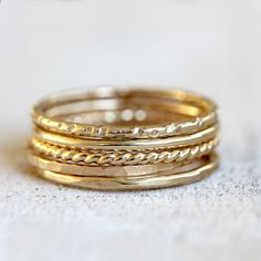 5 solid gold stacking rings.  https://www.etsy.com/listing/175450873/gold-stacking-rings-14k-set-of-5-gold