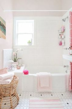 White + pink bathroom.