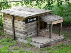 Wooden shipping pallets were repurposed to make this dog house.