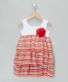 This frock touts colorful stripes and a flowery embellishment. The easy slip-over silhouette lends to fuss-free dressing and more time for play. Polyester / cottonDry clean