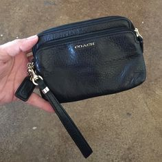 Black Coach Wristlet Two zipper pocket coach wristlet, with card slots in main pouch. Coach Bags Clutches & Wristlets