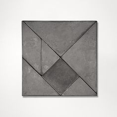 Concrete Tangram grey: imagine an indoor path made of these so it could be used multi purposely, for puzzling, creating patterns and experimenting with tiling