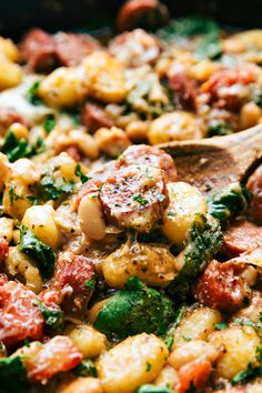 ONE skillet delicious dinner recipe. Veggies, sausage, and spices mix together to make an incredible dinner in thirty minutes.