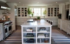 I like the glass front cabinets that go to the countertop--on either side of the window.