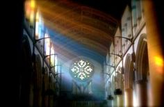 Light streaming through the clerestory windows and the incense filled Cathedral on All Saint's Day.