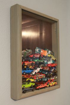 Shadow boxes are a great way for displaying any collection. Using one to showcase matchbox cars is perfect in a little boy's room or in the man cave. Like this idea? See the house it came from here. It's for sale! http://www.trulia.com/property/3110202504-2525-7th-St-East-Moline-IL-61244