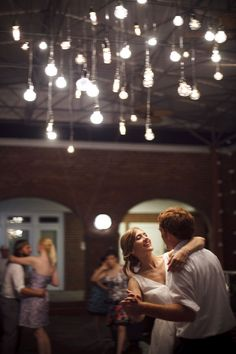 Vintage-y Edison bulb light feature lends a romantic, but unique, vibe to a dance floor.
