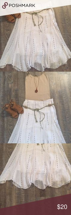 Boho flowy white skirt This skirt is white with neutral tones. The braided belt is included. I would definitely say this skirt is so boho. The bottom of the skirt is scalloped to create a nice detail. Tailor B. Moss Skirts