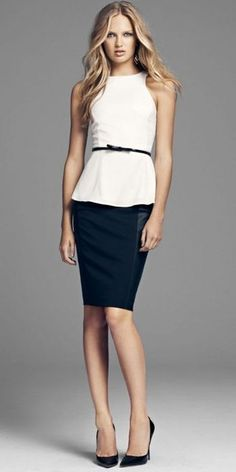 Subtle peplum blouse over a dark pencil skirt.